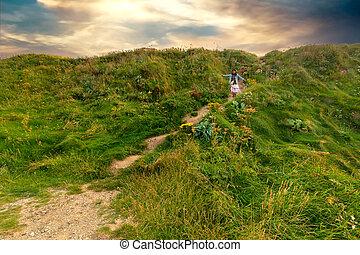 Woman walking in a wild coastline