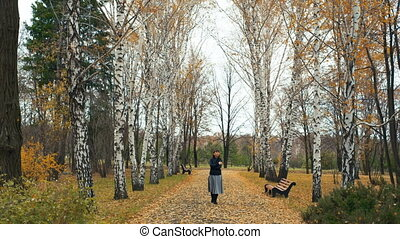 Woman Walking in Autumn Park