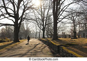 woman walking in cemetery