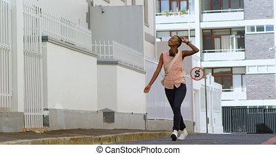 Woman walking in city street 4k - Happy woman walking in...