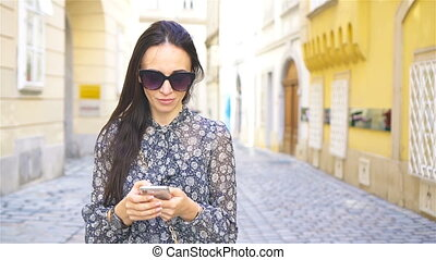 Woman walking in city. Young attractive tourist outdoors in european city