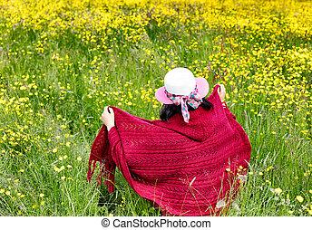 Woman walking in field with flowers