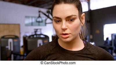Woman walking in fitness studio 4k