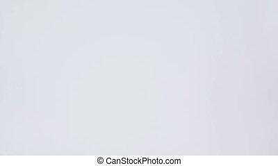 Woman walking in her underwear against a white background