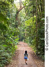 Woman walking in jungle