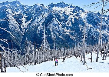 Woman  walking in mountains.