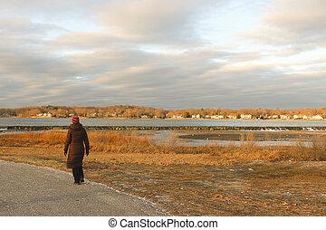 woman walking in park by beach