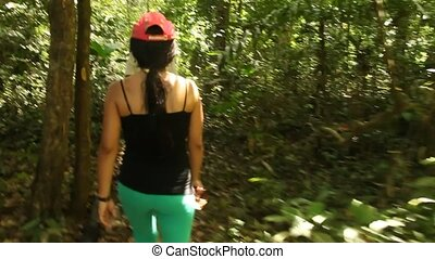 Woman Walking In Rainforest