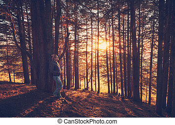 Woman walking in the autumn forest