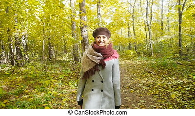 Woman Walking in the autumn park