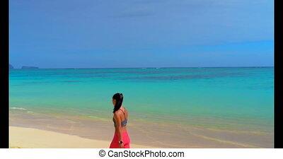 Woman walking in the beach 4k