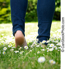 Woman walking in the park barefoot