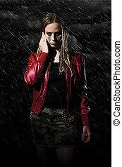 woman walking in the rain vertical