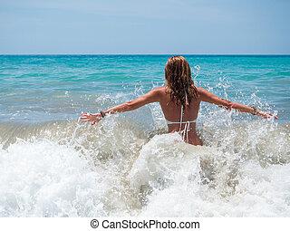 Woman walking in the sea