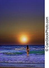 woman walking in the sea.
