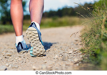 Woman walking insports shoes, sport and fitness outdoors