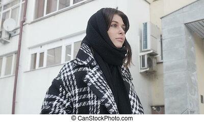 Woman walking near high-rise building - Beautiful woman in...