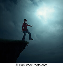 Woman walking off cliff - A woman walking off of a cliff...