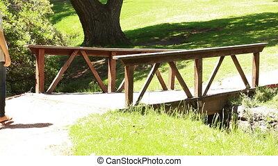 Woman walking on a bridge