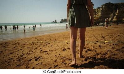 Woman walking on Dona Ana Beach