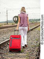 woman   walking on rail road