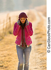 woman walking outdoors in winter