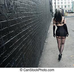 woman walking - back of a woman walking