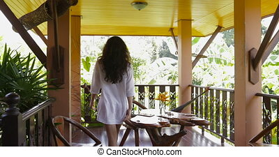 Woman Walking Terrace Looking At Tropical Forest Landscape...