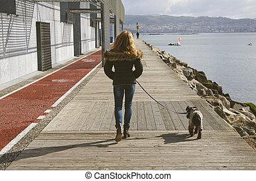 woman walking the dog