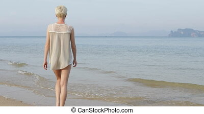 Woman Walking To Water On Beach, Young Girl Back Rear View...