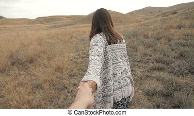 Woman Walking With Boyfiend - woman runs holding a man's...