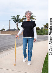 Woman walking with cane
