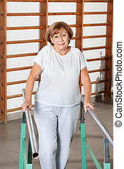 Woman Walking With The Help Of Support Bars