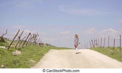 Woman Walks Along An Empty Road