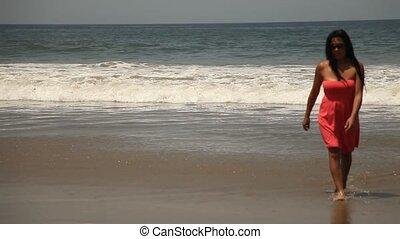 Woman Walks At Beach
