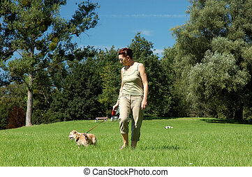 Woman walks her dog