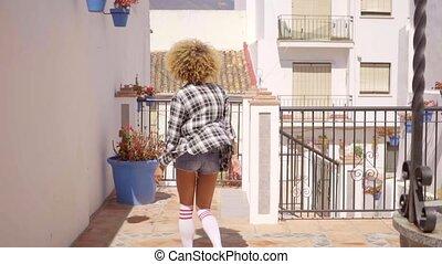 Woman Walks The Mediterranean Backyard Along - Young sexy...