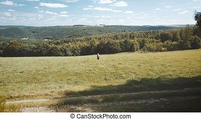 woman wander through beautiful landscape. drone overflight