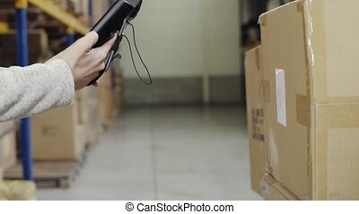 Woman warehouse worker with barcode scanner. - Young woman...