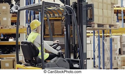 Woman warehouse worker with forklift. - Young woman worker...