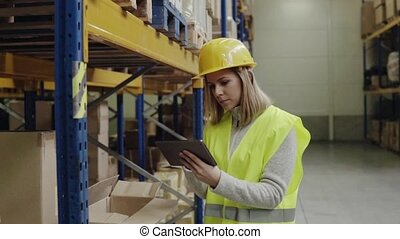 Woman warehouse worker with tablet. - Young woman warehouse...