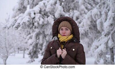 Woman warming herself