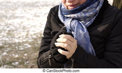 Woman Warming Up Cold Hands Outside Handheld