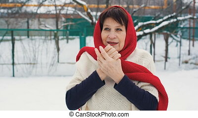 Woman Warms Hands at winter