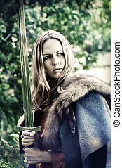 Woman warrior with sword - Beautiful blond sexy woman ...