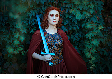 Woman warrior with sword wearing a cuirass. On the shoulders of her cloak.