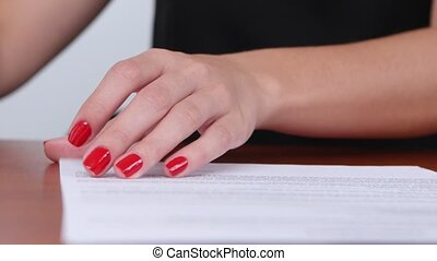 Woman was satisfied with the terms of the contract and puts the stamp. Close up