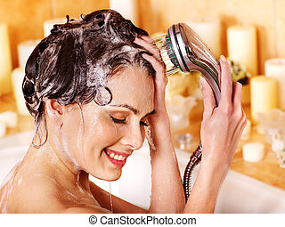 Woman washes her head at bathroom. - Woman washes her head...