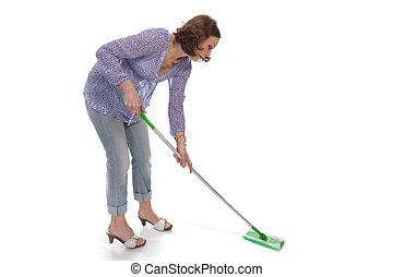 woman washes up the floor by a swab over white