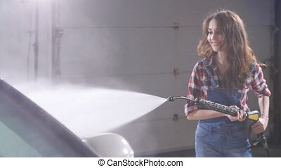 Woman Washing car with high pressure blaster